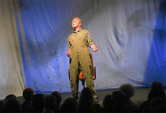 Actress standing onstage in flight suit