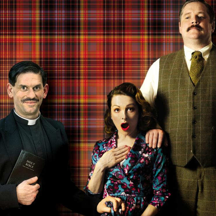 A priest holding a bible, a shocked woman in a blue and pink dress and a man in a suit with her hand on the girls shoulder stand in front of a red tartan background.